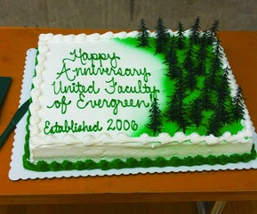 "sheet cake with green trees and the message ""Happy Anniversary United Faculty of Evergreen Established 2006"